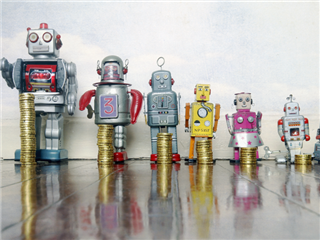 A group of toy robots in a line grouped by size from biggest to smallest, in front of each robot there is a stack of coins that coincides with the size of the robot - AI return on investment