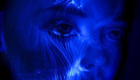 Blue face with wavy lines