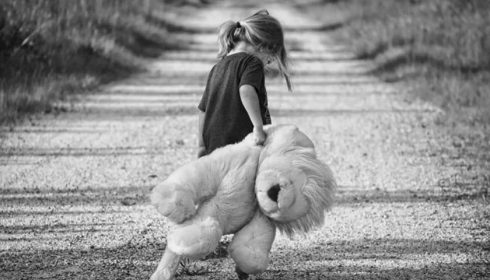 Girl with a plush toy