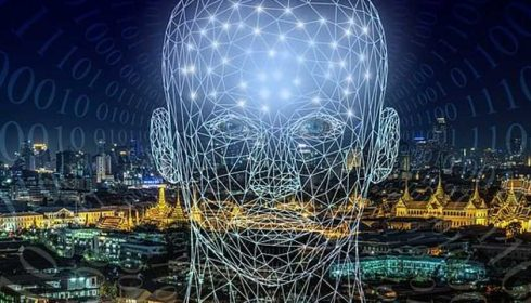 Wireframe head on cityscape and binary background