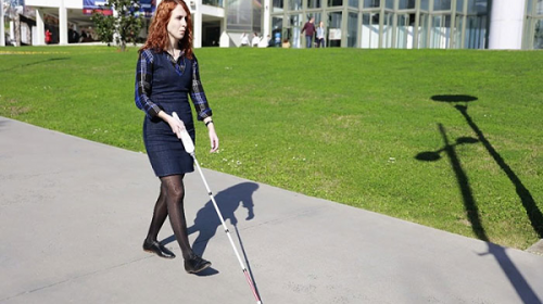 Woman with Smart Cane