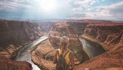 Woman looking out at the Grand Canyon